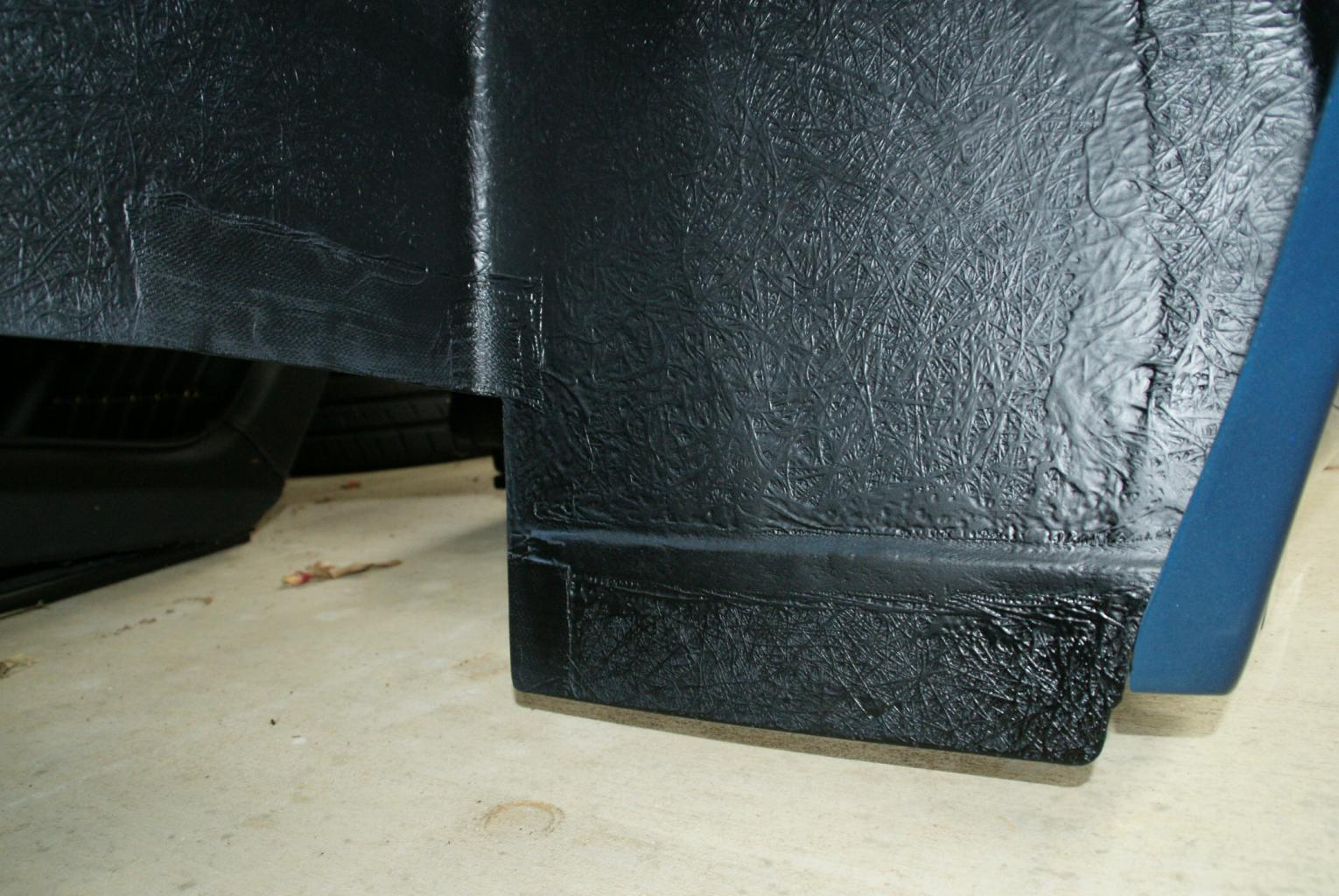 Flaps to Minimize Tire Debris-rear-wheel-well-001-jpg