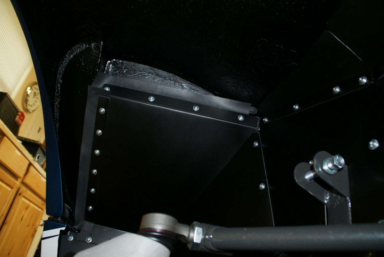 Flaps to Minimize Tire Debris-under-wheel-well-004-jpg